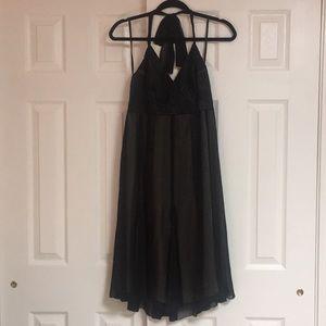 Knee length satin and sheer dress.